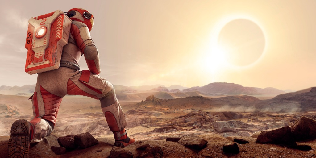 astronaut-on-mars-kneeling-and-watching-eclipse-at-sunset-picture-id693335612