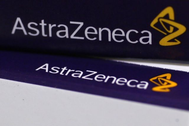 File photograph shows the logo of AstraZeneca on medication packages in a pharmacy in London
